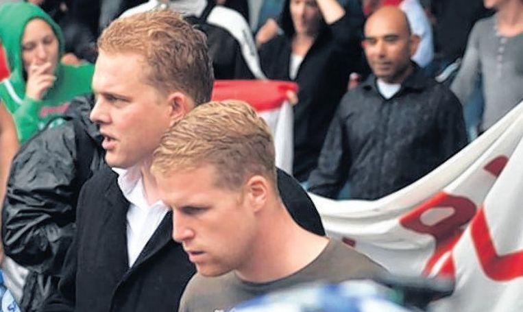 Rechts-extremist Paul Peters (links) bij de mars. Beeld Onderzoeksgroep Kafka
