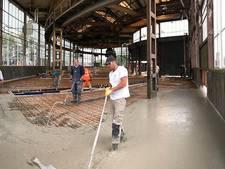 VIDEO: Renovatie polygonale loods: tien cementwagens, één vloer