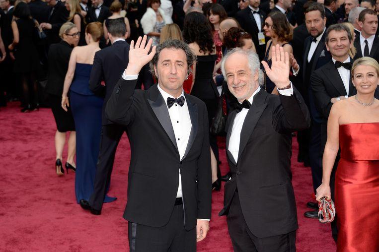 Regisseur Paolo Sorrentino en acteur Toni Servillo tijdens de uitreiking van de Oscars in 2014.  Beeld Getty Images