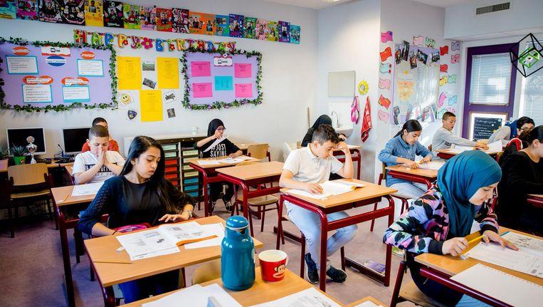Leerlingen van groep 8 beginnen aan hun eindtoets. Beeld anp