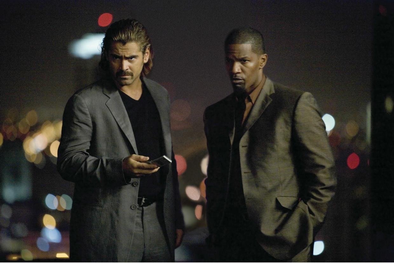 Colin Farrell (links) en Jamie Foxx in Miami Vice (de film, uit 2006) van Michael Mann. Beeld
