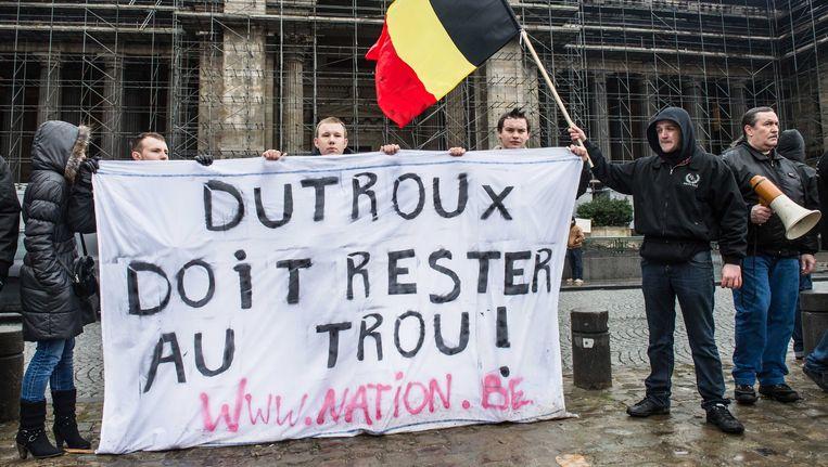 Protest in Brussel, afgelopen februari, tegen de voorwaardelijke invrijheidstelling van Marc Dutroux. Beeld AP