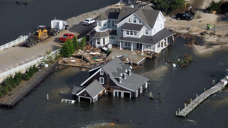 Beschadigde huizen aan de kust van New Jersey, Beeld REUTERS