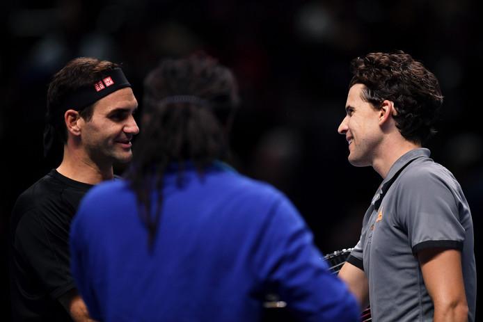 Roger Federer en Dominic Thiem (rechts).