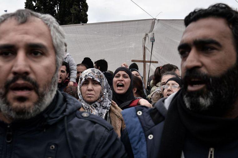 Syrische vluchtelingen demonstreren voor een verblijfsvergunning in Athene. Beeld null