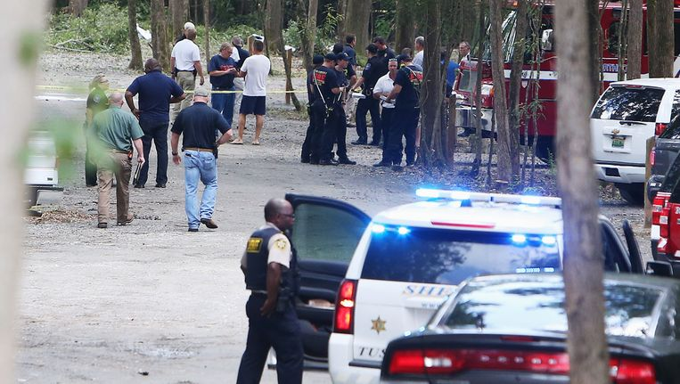 Hulpverleners haastten zich naar de plek van de crash, maar de inzittenden konden niet meer worden gered. Beeld AP