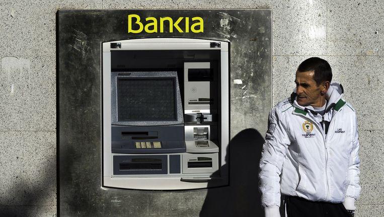 Een filiaal van Bankia in Madrid. Beeld AP