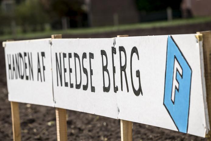 Protestbord van actiegroep Needse Berg.