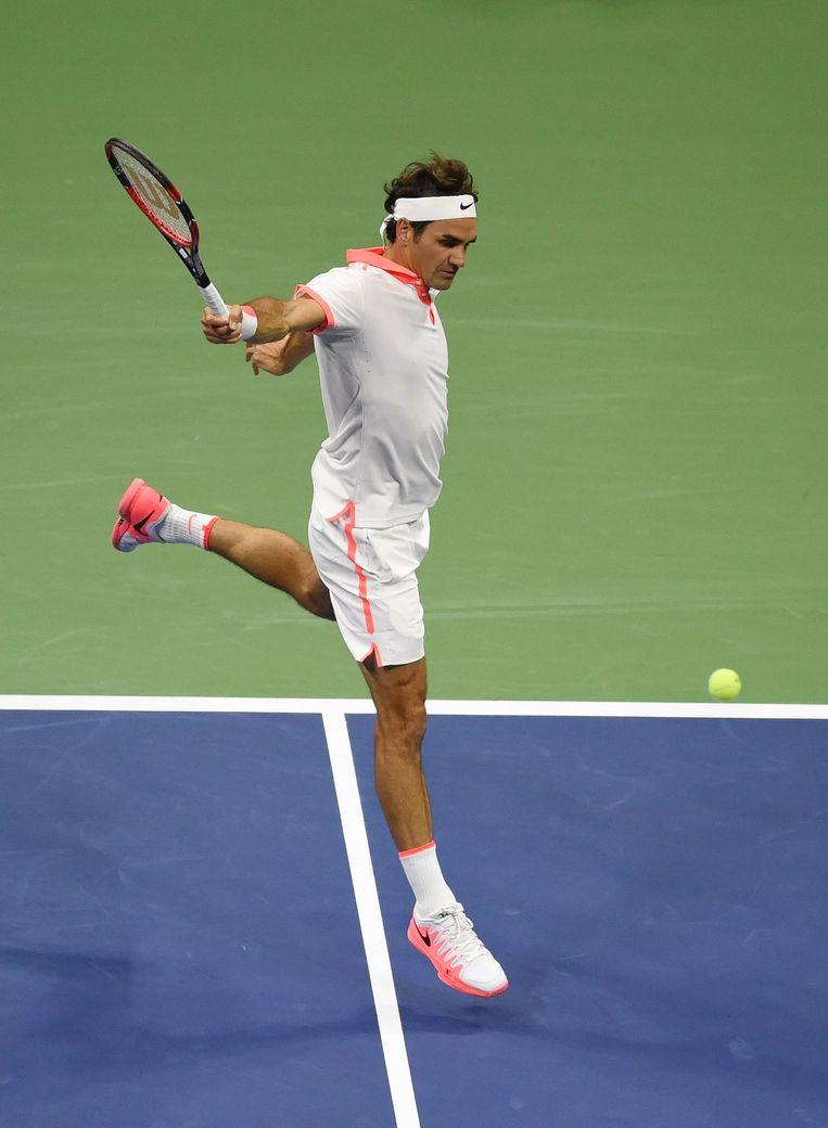 USOpen 2015. Roger Federer retourneert een service van Novak Djokovic. Beeld AFP