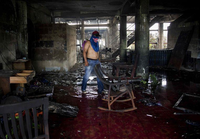In dit huis in Managua kwamen zes mensen om het leven nadat er tijdens straatprotesten brand was gesticht. Beeld EPA