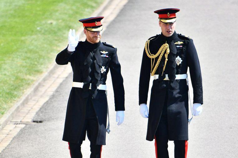 De prinsen Harry en William tijdens die eerste zijn huwelijk met Meghan Markle op 19 mei 2018.