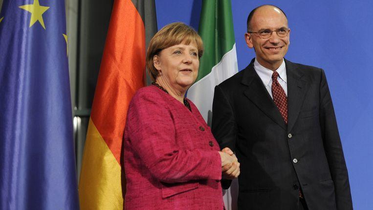 De Duitse bondskanselier Angela Merkel met de nieuwe Italiaanse premier Enrico Letta Beeld afp