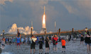 Hundreds of people pack the Canaveral National Seashore in Cape Canaveral, Fla., Thursday, Sept. 8, 2016, to witness the launch of a United Launch Alliance Atlas V rocket as it lights up the sky during liftoff from Launch Complex 41 at the Cape Canaveral Air Force Station on the OSIRIS-REx mission,NASA first asteroid sample return mission.  (Craig Rubadoux/Florida Today via AP)
