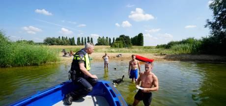 Rijkswaterstaat waarschuwt zwemmers met posters in Pools, Duits en Arabisch