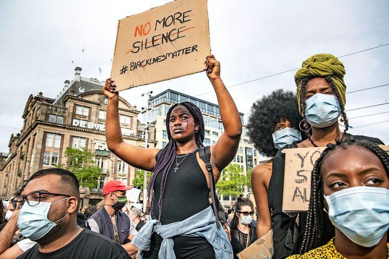 Protest op de Dam in Amsterdam. Beeld Guus Dubbelman / de Volkskrant