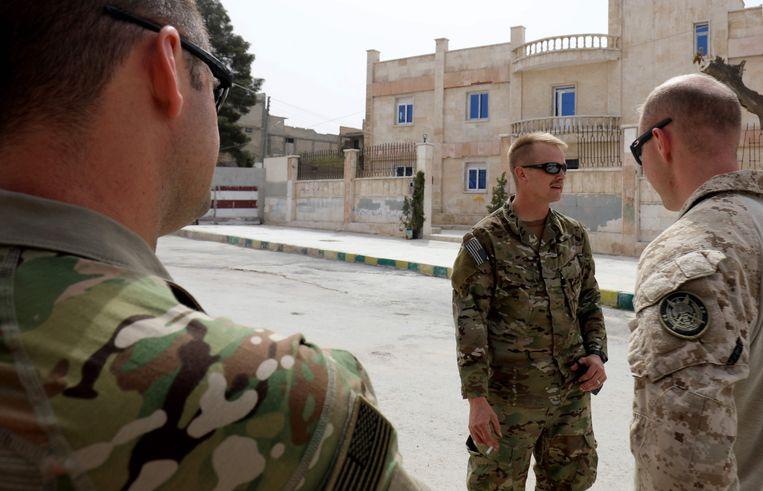 Amerikaanse soldaten in de Noord-Syrische stad Manbij. Beeld AFP