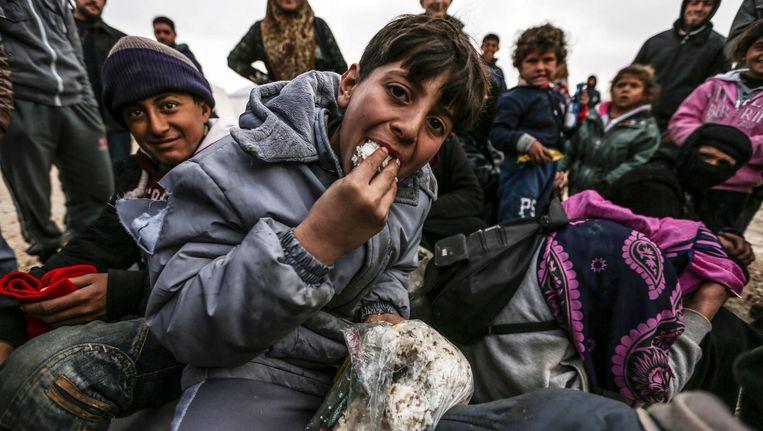 Syrische vluchtelingen in de buurt van Azaz, in het noorden van het land. Beeld afp