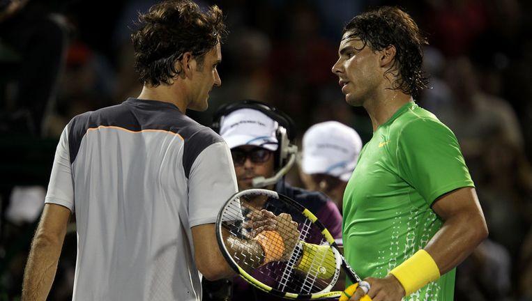 Federer en Nadal bij de wedstijd. Beeld afp