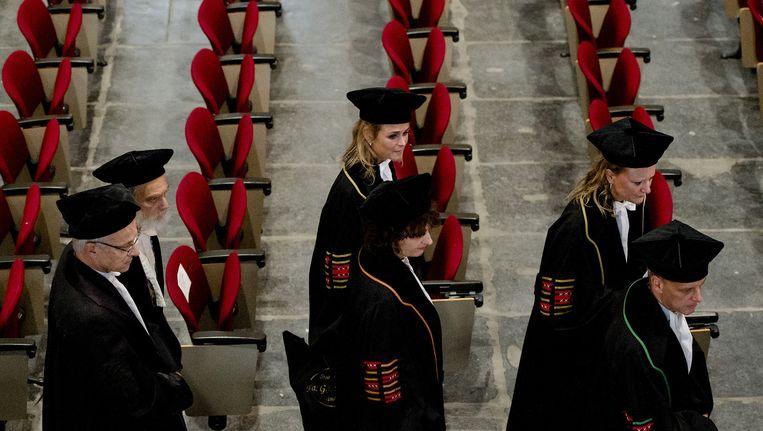 Binnenkomst van het cortege van hoogleraren van de Universiteit van Amsterdam tijdens de 382ste Dies Natalis, een bijzondere zitting van het College voor Promoties. Beeld anp