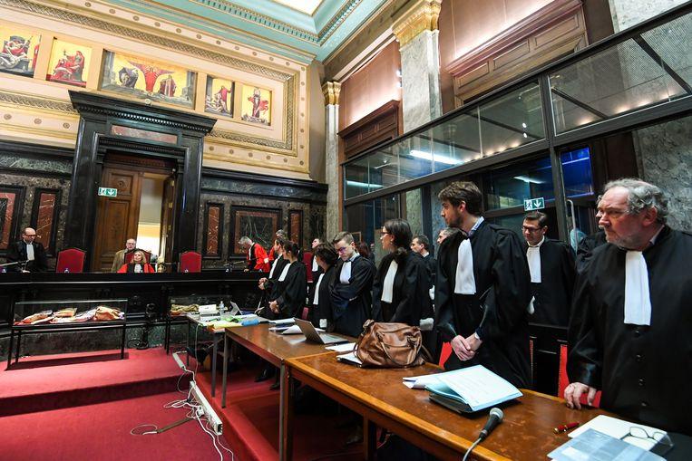 De advocaten in het proces rond de aanslag op het Joods Museum op een rijtje.