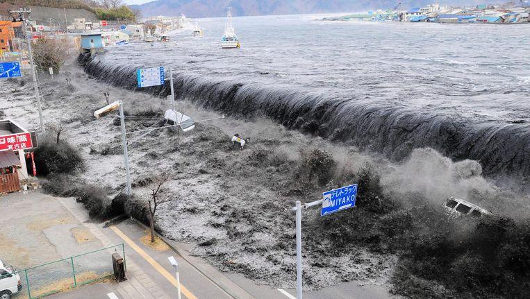 De vloedgolf na de aardbeving. Beeld afp