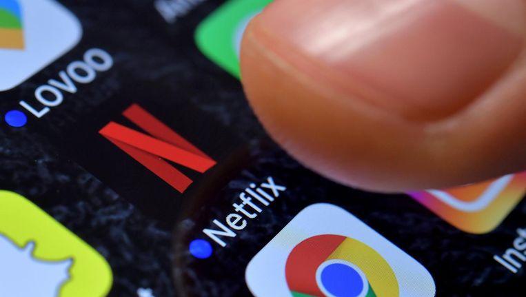 Ongeveer 4 miljoen mensen hebben de app van Netflix op hun smartphone staan. Beeld anp