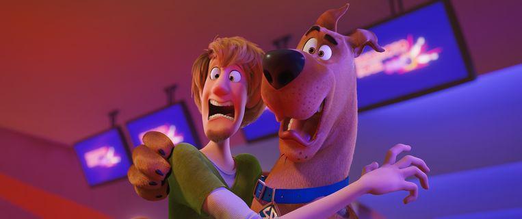 Baasje Shaggy met zijn Duitse dog Scooby Doo. Beeld