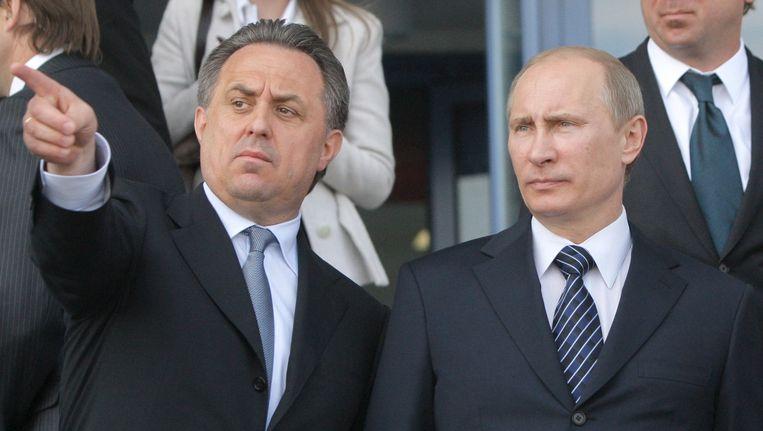 Vitaly Mutko, de Russische minister van Sport, in het gezelschap van president Vladimir Poetin.