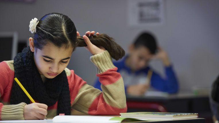 Een leerling buigt zich over de Cito-toets, begin februari Beeld ANP