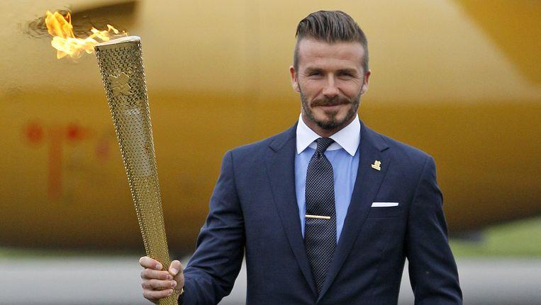 David Beckham met de olympische vlam Beeld null