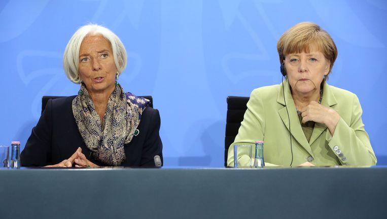 Merkel en Lagarde in mei tijdens een persconferentie. Beeld Getty Images