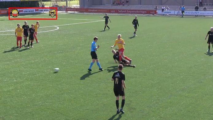 Een speler van FC Winterswijk schoffelt een tegenstander hard onderuit.