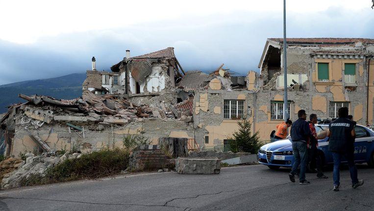 De overblijfselen van een huis in het getroffen stadje Amatrice. Beeld anp