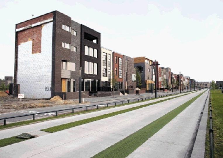 De wijk Roombeek is zo goed als heropgebouwd, hoewel lang niet alle kavels verkocht zijn. (FOTO HERMAN ENGBERS) Beeld