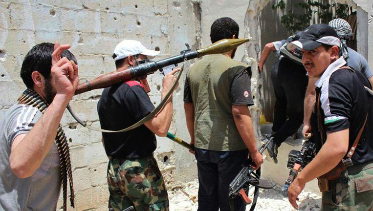Syrische rebellen in de oude stad van Homs.