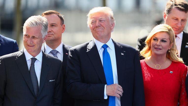 Donald Trump naast de Belgische koning Filip en de Kroatische president Kolinda Grabar-Kitarovic Beeld anp