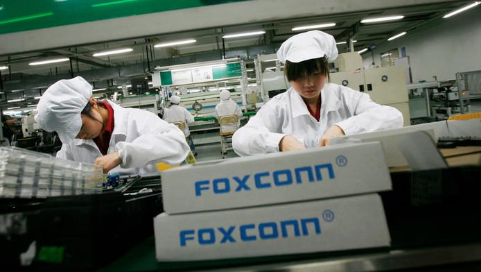 Werkneemsters van Foxconn in een fabriek in Longhua, in de zuidelijke Chinese provincie Guangdong.