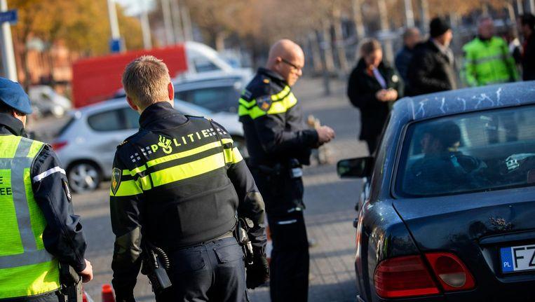 Wanneer de politie verdachten zoekt, komen 'andere' Nederlanders te vaak ten onrechte in beeld. Beeld Jeroen Jumelet/ANP