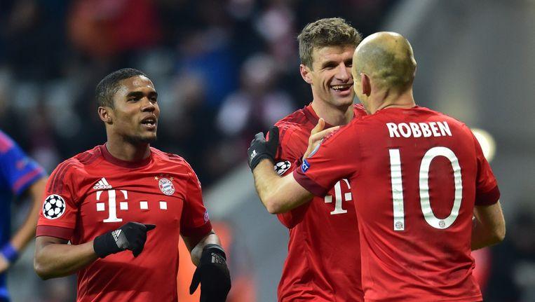 Costa, Mueller en Robben na de 3-0 van Mueller Beeld afp