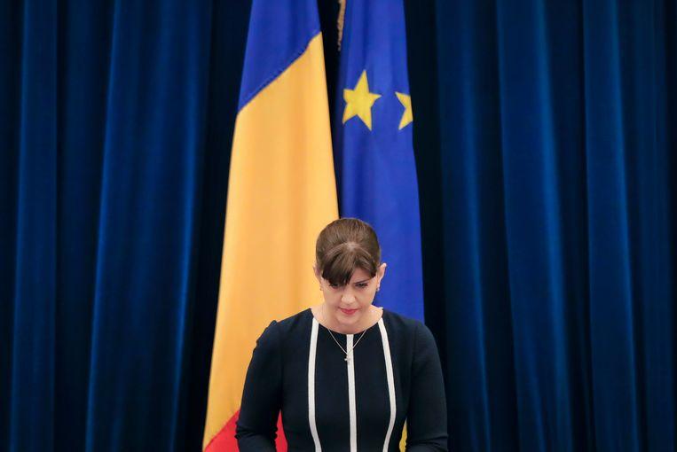 Laura Codruta Kovesi leest het jaarlijkse rapport van het Roemeense anticorruptie-agentschap voor. Beeld AP