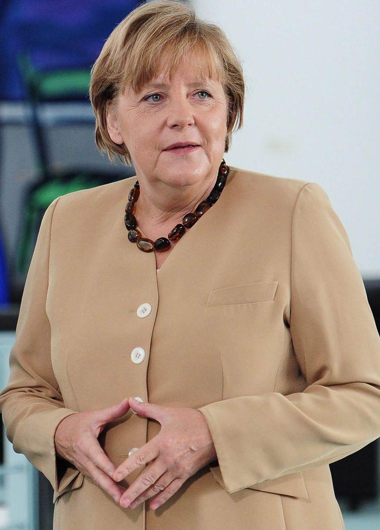 De kenmerkende 'Merkel Raute'.  Beeld EPA