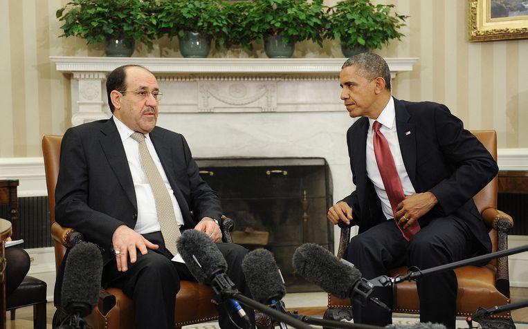 Nouri al-Maliki in gesprek met president Obama in 2013. Beeld epa
