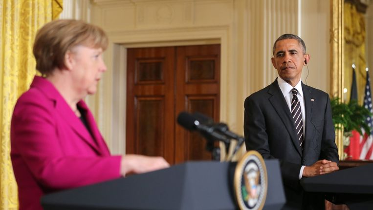 De Amerikaanse president Barack Obama en Duitse bondskanselier Angela Merkel tijdens een persconferentie in het Witte Huis vandaag.