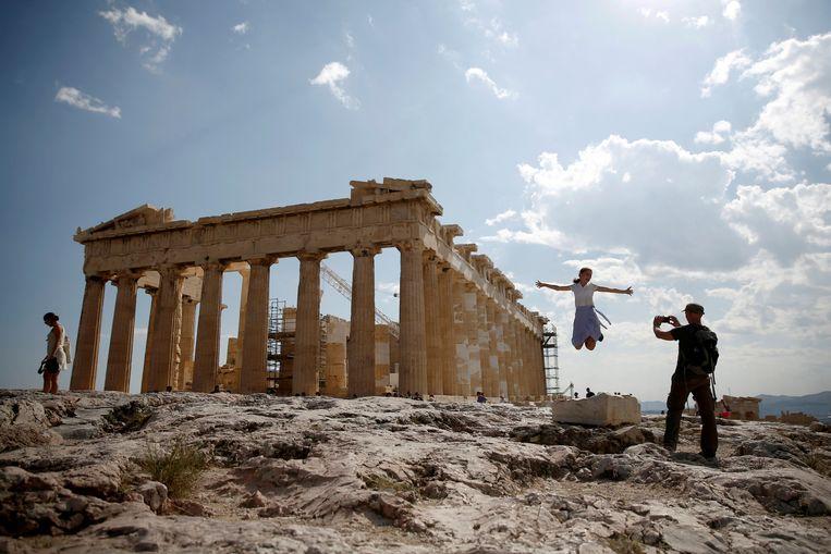 Toeristen op de Akropolis in Athene.  Beeld REUTERS