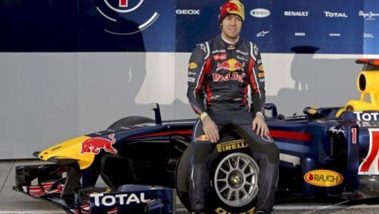 Sebastian Vettel voor de nieuwe Red Bull-auto. EPA Beeld