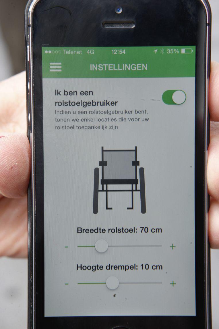 In de app kan je de breedte van de rolstoel en de hoogte van de drempel instellen.