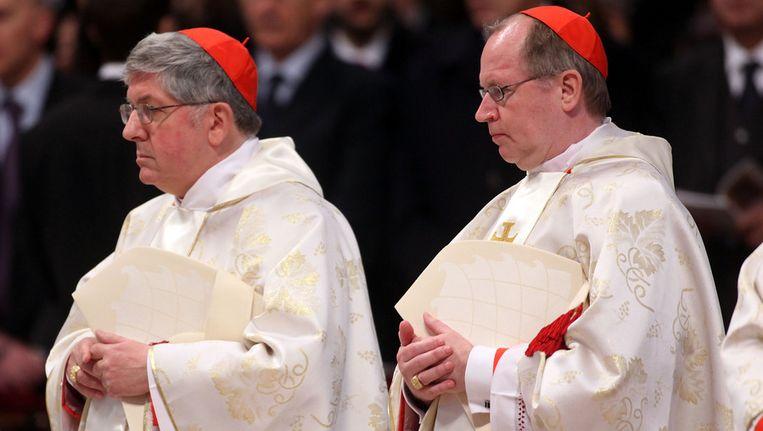 Kardinaal Eijk (rechts) tijdens de ceremonie Beeld getty