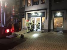 Brand door kerstverlichting in winkel Voorthuizen