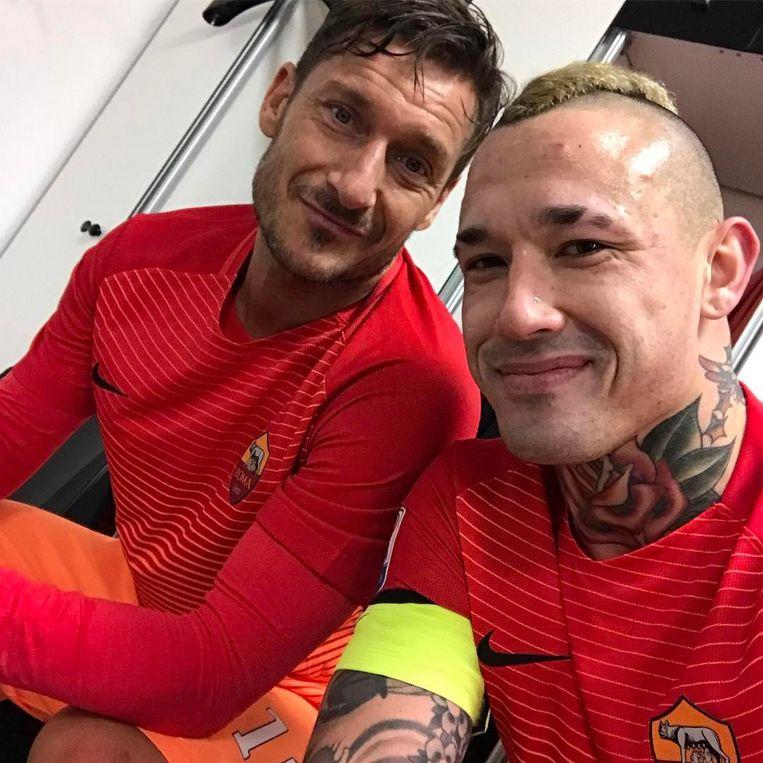 Samen met Totti.