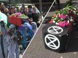 Milieubeweging rouwt met begrafenisstoet om klimaat